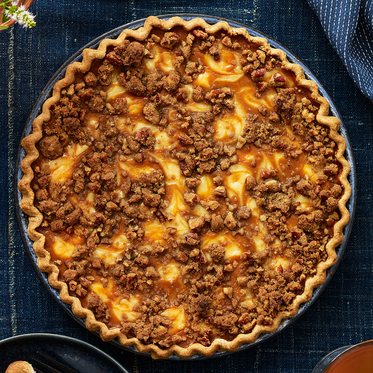 This riff on the Thanksgiving favorite combines a traditional pumpkin pie filling with swirls of sweetened cream cheese. And since it's only Thanksgiving once a year, we've topped it all off with a buttery spiced-pecan topping. This easy pie recipe will please anyone at your table this holiday.
