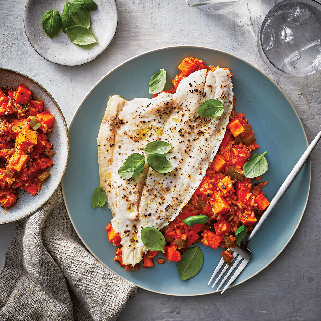 This dish boasts delicate, flaky flounder and a sweet, fragrant curry made with rich coconut milk, tender sweet potatoes and brown rice. The flounder—which can be substituted with tilapia, if desired—cooks well on top of the curry. Adding the flounder to the slow cooker for the last 20 minutes allows it to steam without overcooking. For the prettiest appearance, substitute whole fresh basil leaves for the sliced basil. To save prep time, purchase a package of prepeeled, prechopped sweet potatoes, such as the 16-ounce steam-in-bag package from Archer Farms, and use 14 ounces from it.
