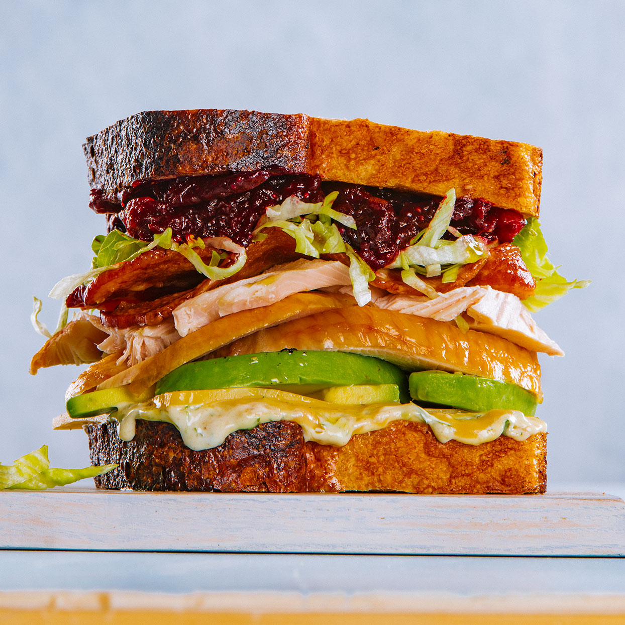 After Thanksgiving, we cannot get enough leftover turkey recipes—and this healthy turkey avocado sandwich will help you use up Thanksgiving leftovers and more. If you really want to do this sandwich up, chef Hugh Acheson suggests searing a slice of stuffing or bread pudding until it's nice and crispy and putting it between the turkey and avocado.