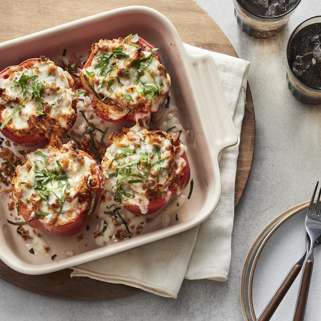 Chicken Parm gets a fun low-carb and gluten-free twist with these cheesy stuffed peppers with chicken and quinoa. Serve with a salad for a healthy dinner that's easy to prep too.