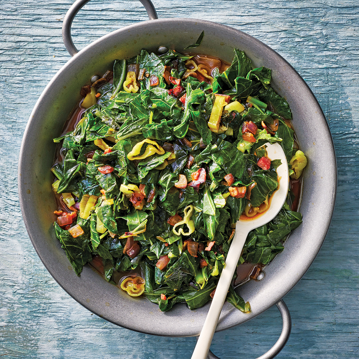 Collard greens have large, dark green leaves that are dense with vitamins, calcium and fiber. The briny pepperoncini and salty pancetta add enough brightness to this dish to balance the collards' vegetal flavor. These slow-cooker collard greens pair perfectly with braised meat or barbecue.