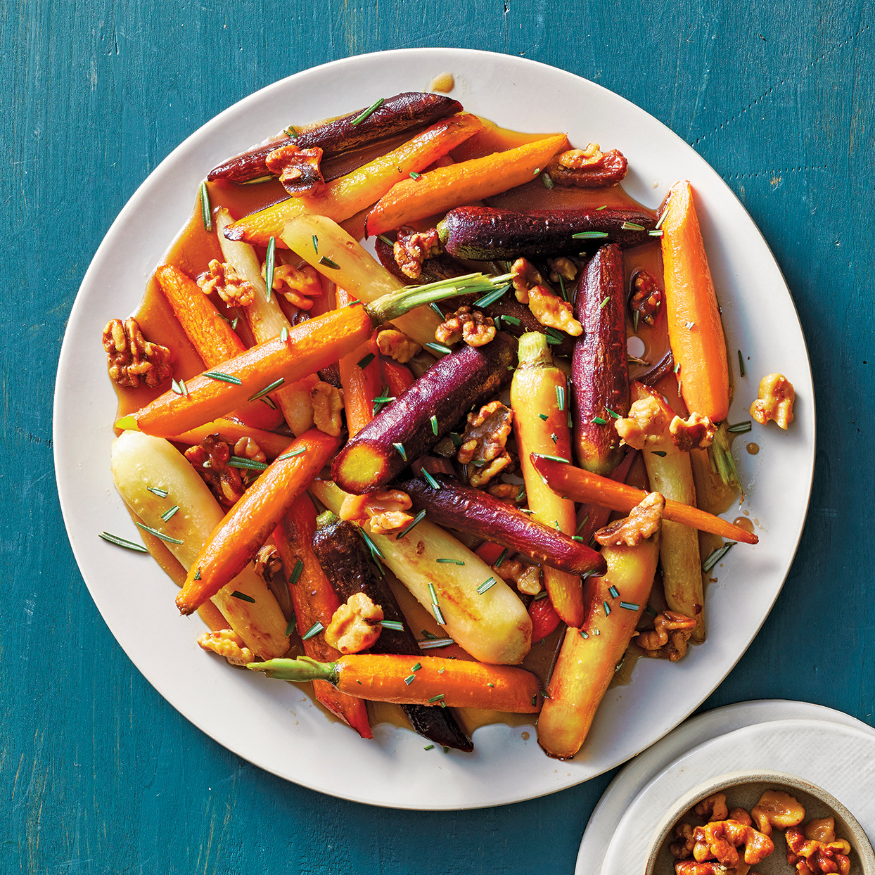 The hint of maple syrup and brandy elevates these slow-cooker carrots, transforming them into a holiday-worthy side dish. You can easily double this to feed a crowd. We use stem-on rainbow carrots for their beauty, but regular carrots work just as well.