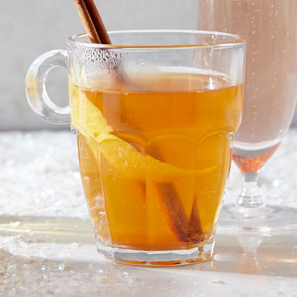 Flavored decaf tea adds a seasonal twist to a traditional hot toddy recipe. You can use any flavor of tea for this easy cocktail, but we love the comforting notes of pumpkin-spice in the fall and winter.