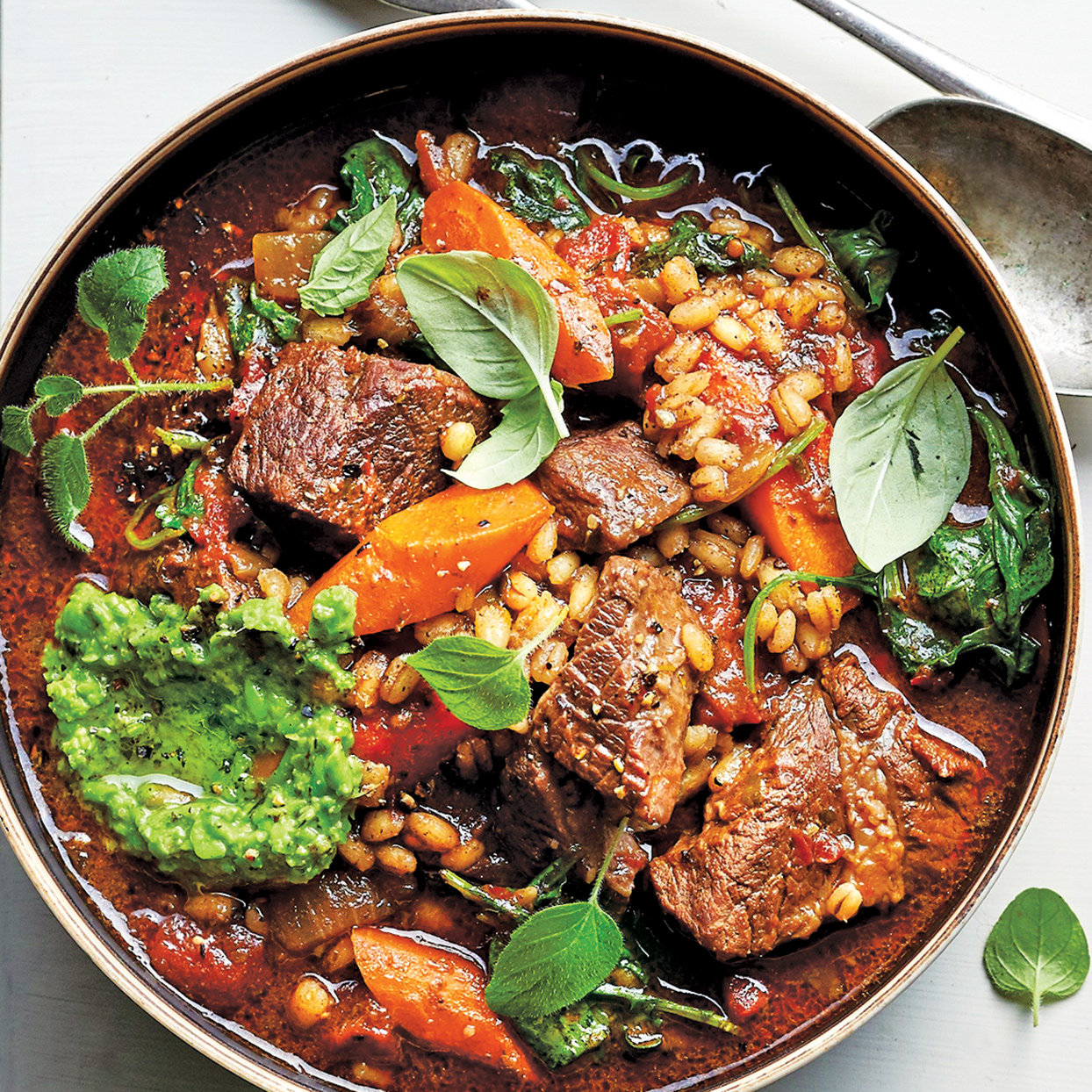 Hearty, thick, rich—this is just how a winter soup should be. The meat and carrots become tender yet retain their texture, and the kale offers freshness. Garnish each serving of this slow-cooker beef and barley soup with additional pesto and fresh basil and oregano sprigs, if desired.