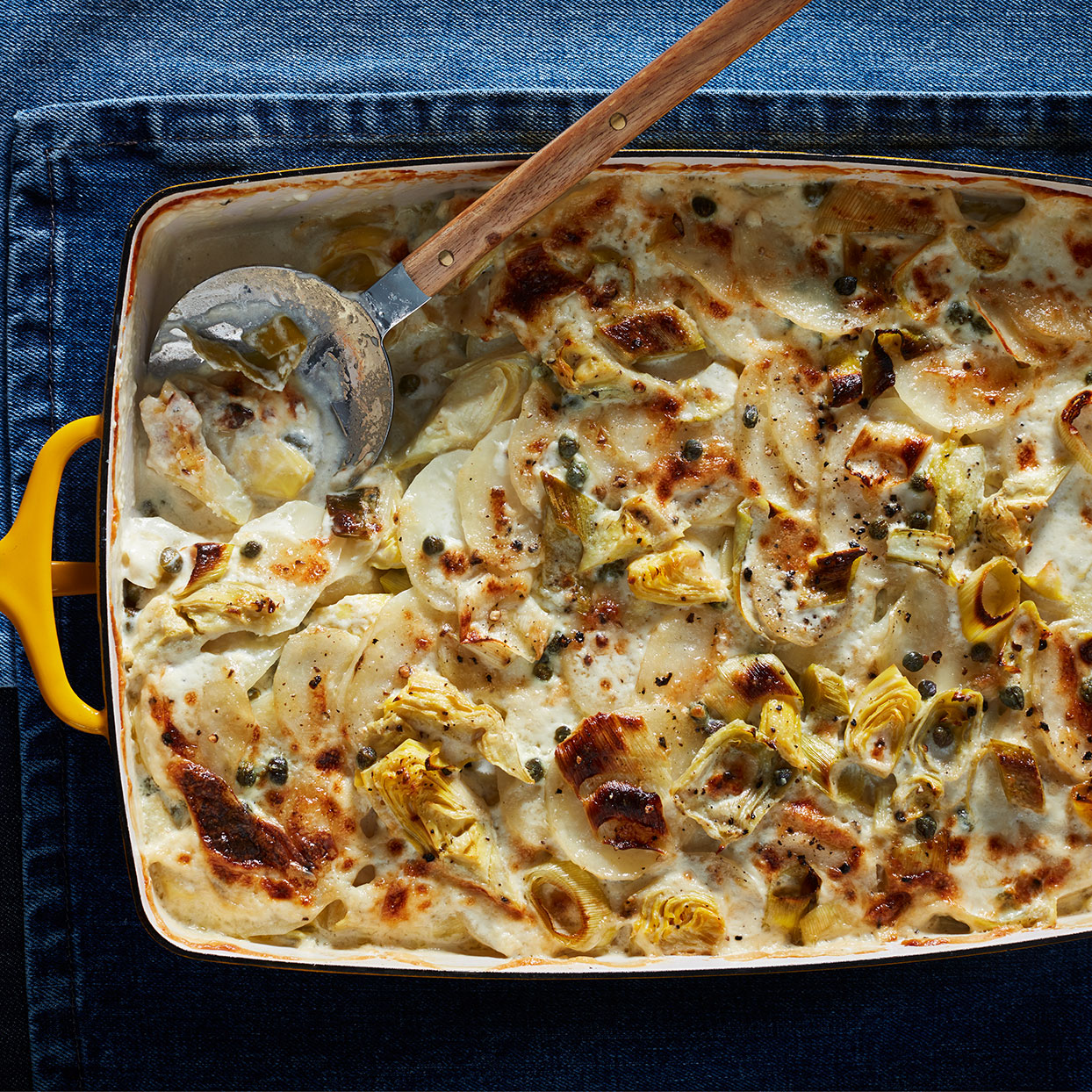 This gratin dish has all of the craveable flavors of artichoke dip in a more sophisticated form. It makes a terrific side with any roasted meats or poultry.