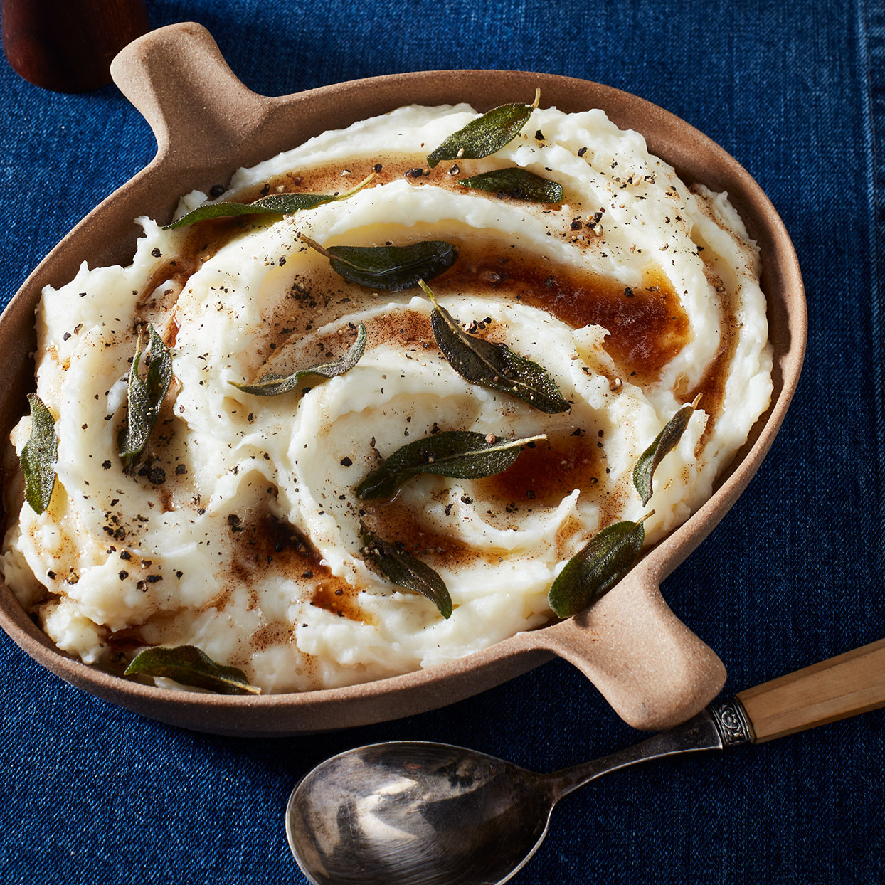 Russets are the creamiest, best potatoes for mashed potatoes. A drizzle of browned butter on top adds a nutty flavor that mingles nicely with tangy yogurt and fragrant sage.
