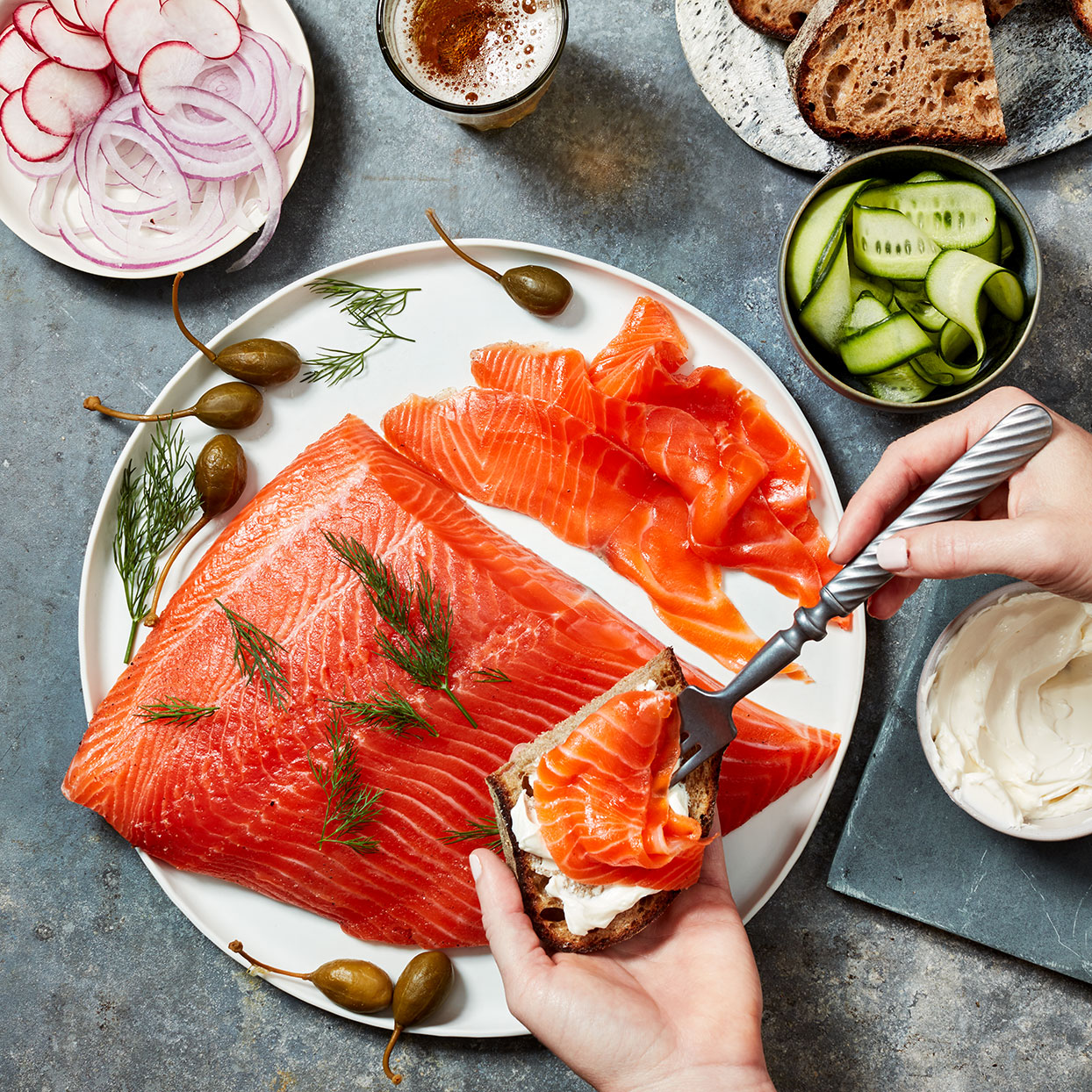 While this type of cured salmon, called gravlax, is usually made with skin-on salmon, this recipe removes the skin and rubs the curing mixture on both sides for better flavor penetration. Ask your fishmonger for a center-cut piece of salmon that's consistently 1½ inches thick for the best results. Green peppercorns are often sold in a brine, but you'll want to seek out dried ones for this recipe.