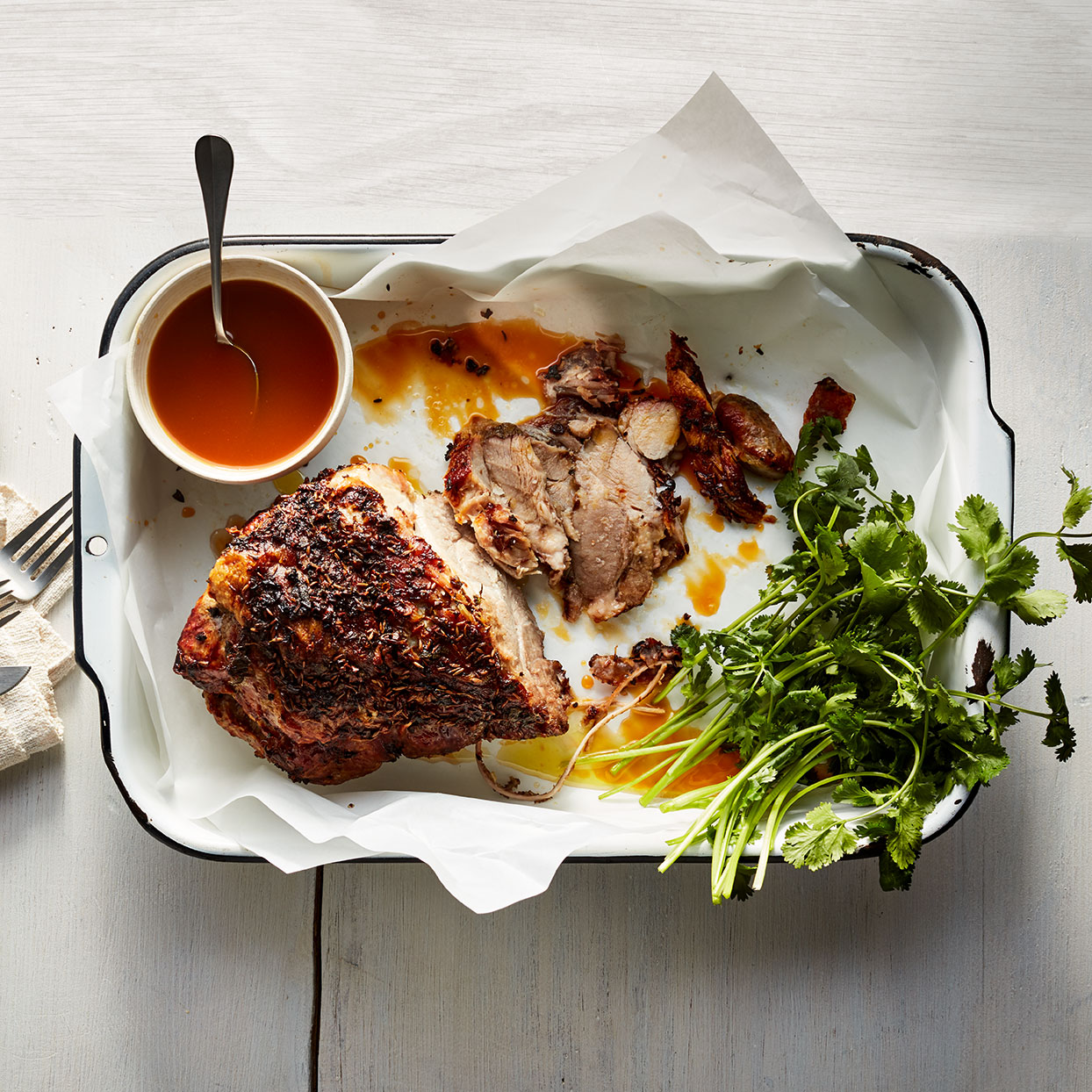 Pork shoulder makes a wonderful roast because it has enough fat to keep it moist and tender during low and slow cooking. The citrus sauce has a smoky, agave sweetness from the tequila and produces a bright counterpoint to the unctuous meat. Serve any extra sauce for dipping.
