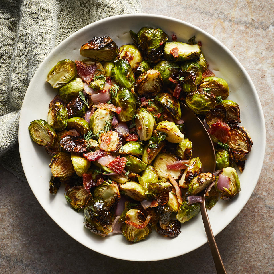 These super-crispy and browned air-fryer Brussels sprouts with sweet onions and salty bacon—all amped up with bright lemon juice—are sure to be a hit, whether you serve them for a weeknight side dish or as part of your holiday spread for Thanksgiving. This recipe makes enough to serve eight but is easily halved, though once you taste it you may well want a double serving. And if you prefer a vegetarian side, simply omit the bacon.