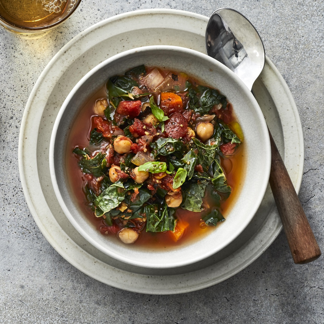 This Mediterranean stew is a healthy dinner chock-full of vegetables and hearty chickpeas. A drizzle of olive oil to finish carries the flavors of this easy vegan crock-pot stew. Swap out the chickpeas for white beans for a different twist, or try collards or spinach in place of the kale. Any way you vary it, this stew is sure to go into heavy rotation when you are looking for healthy crock-pot recipes.