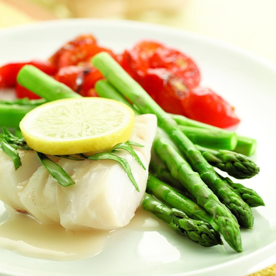 Poached cod asparagus recipe eatingwell for How to poach fish