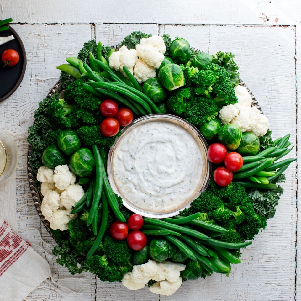 Healthy christmas holiday recipes eatingwell crudit vegetable wreath with ranch dip forumfinder Gallery
